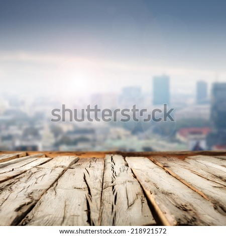 wooden floor and blue landscape of city with free space for you