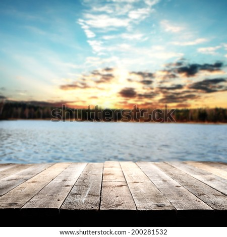wooden floor and lake space  - stock photo