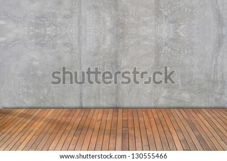 Wooden floor and plaster walls background - stock photo