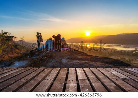 Wooden floor and sunrise on the top of SuPha Taem National Park, Ubonratchathani, Thailand