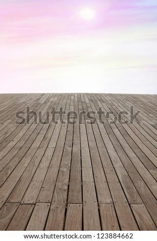 Wooden floor background aspiring to coft color sky - stock photo