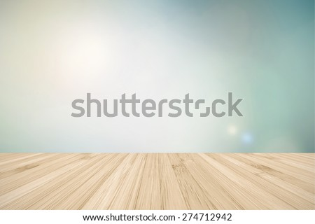 Wooden floor in light beige cream brown color tone with blurred abstract background of clouds and sky in vintage color tone for interiors  - stock photo