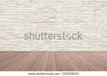 Wooden floor in light red brown tone with rock limestone brick tile wall aged texture pattern background in cream beige color tone: Wood deck with rustic stone backdrop for interior  - stock photo
