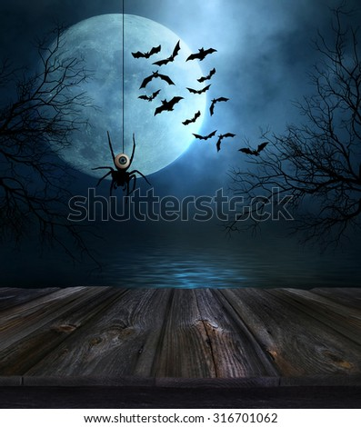 Wooden floor with spooky Halloween background - stock photo