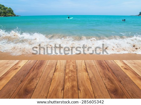 wooden floor with wave splashing to the coast - seascape background - stock photo