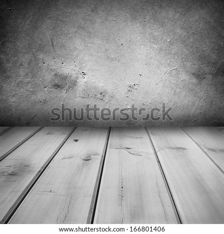 Wooden floorboards and concrete wall  - stock photo