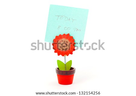 Wooden Flower Holds a Note on a Isolated White Background - stock photo