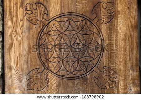 Wooden Flower of Life.  The Flower of life is an ancient symbol of Sacred Geometry and represents the fundamental order of creation. - stock photo