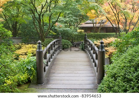 Wooden Foot Bridge in Japanese Garden in the Fall - stock photo