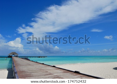 Wooden footbridge leading to the jetty -- maldives seascape - stock photo