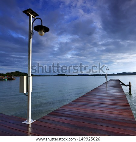 Wooden footbridge on the sea at Gulf of Thailand
