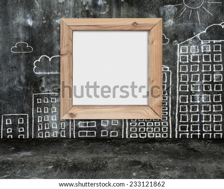 wooden frame blank whiteboard with sun clouds buildings doodles wall on dark mottled concrete floor background - stock photo