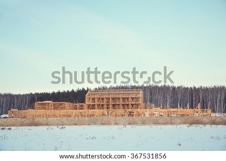 wooden frame ecological house being built. building area outside the city - stock photo