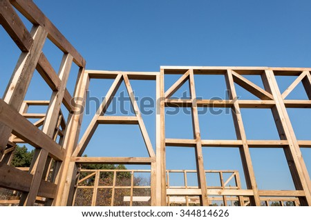 Wooden frame of a new house under construction - stock photo