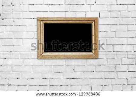 wooden frame on brick wall background - stock photo