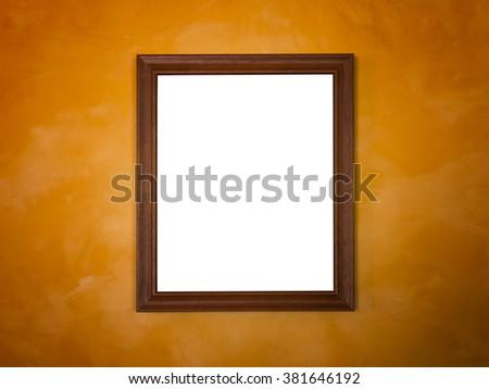 wooden frame on orange vintage wall - stock photo