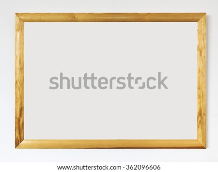 Wooden frame on wall - stock photo