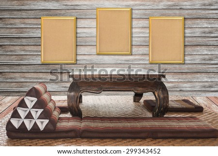 wooden frame on wood wall .  Thai traditional interior living room. local interior concept. - stock photo
