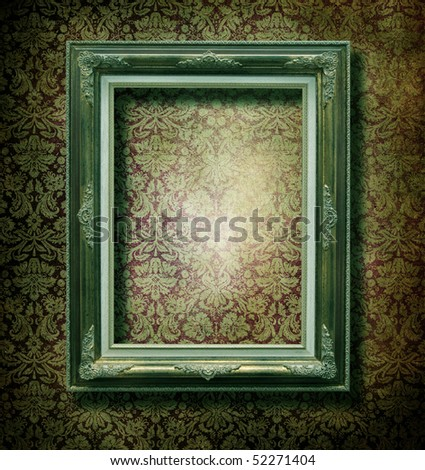 Wooden frame over grunge wallpaper - stock photo