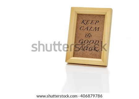 """wooden frame with fill isolated on white paper, write """"KEEP CALM & GOOD LUCK"""" - stock photo"""