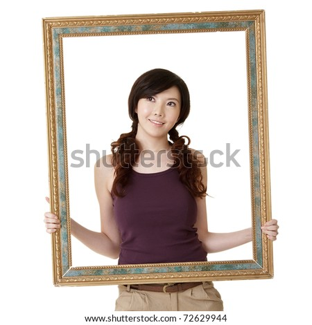 Wooden frame with young woman, closeup portrait on white background.