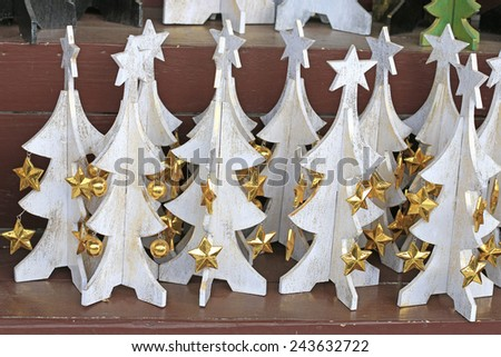 """wooden fun toy """"Christmas tree"""" sale on the street in Bali - stock photo"""