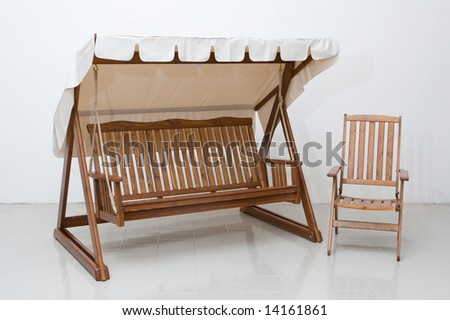 Wooden furniture for a garden - stock photo