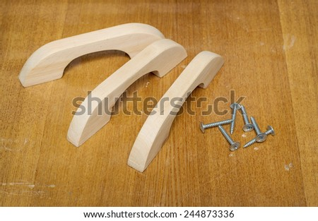 Wooden furniture handles, made of pink alder - stock photo