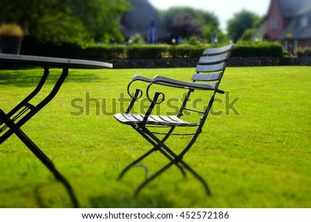 wooden furniture on green grass - stock photo