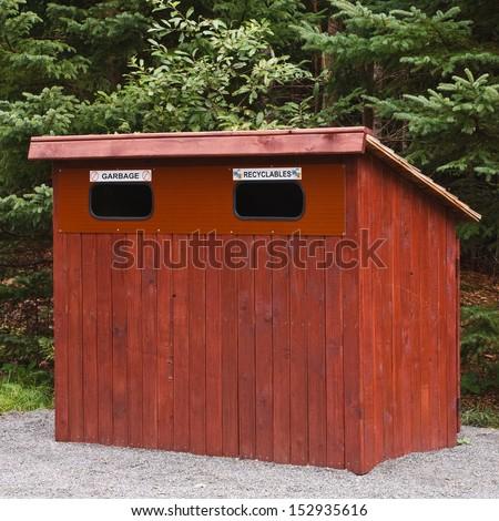 Wooden garbage bin in rural park - stock photo
