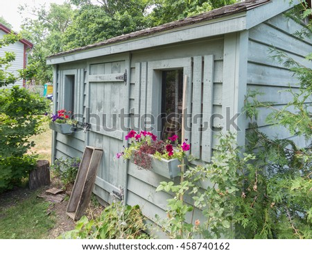 Wooden garden shed - stock photo