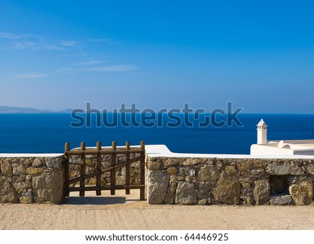 Wooden gate above the blue sea - Greece. Mykonos. - stock photo