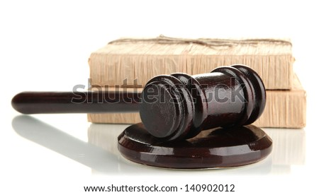 Wooden gavel and books isolated on white - stock photo