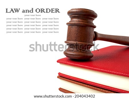 Wooden gavel and books on a white background