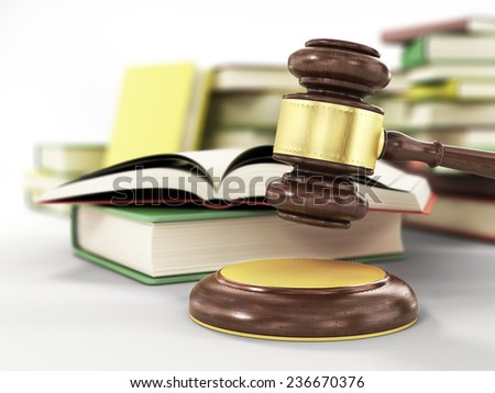 wooden gavel and books on wooden table,on grey background - stock photo