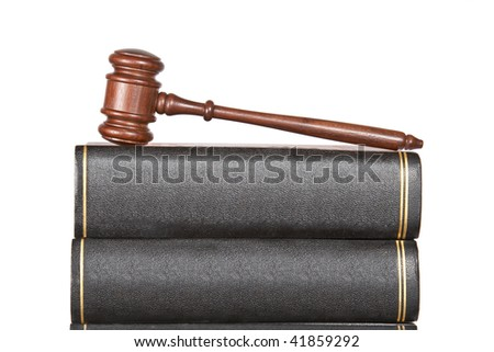 Wooden gavel and law books isolated on white background. Shallow depth of field