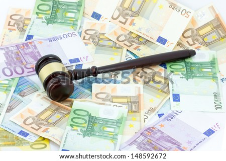 Wooden gavel and money