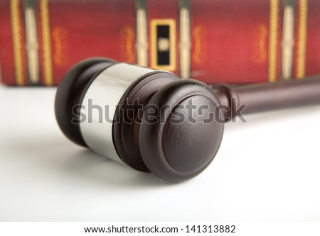 Wooden gavel and old book - stock photo