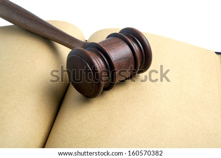 Wooden gavel and open notebook isolated on white background - stock photo