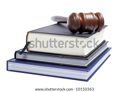 Wooden gavel from the court and law books isolated on white background. Shallow DOF - stock photo