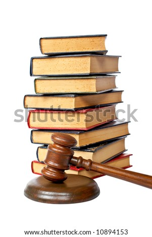 Wooden gavel from the court and old law books isolated on white background. Shallow depth of file - stock photo