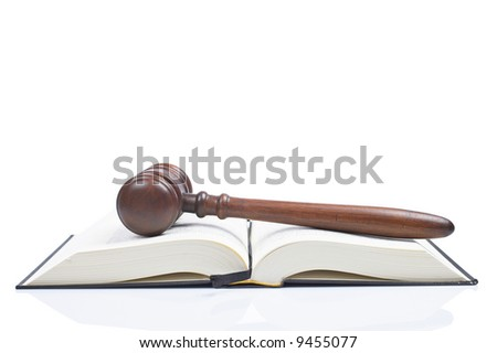 Wooden gavel from the court over the opened law book reflected on white background with space for text. Shallow DOF - stock photo