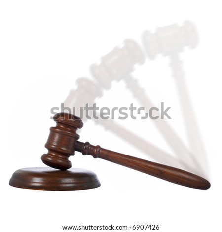 Wooden gavel in action from the court isolated on white background - stock photo