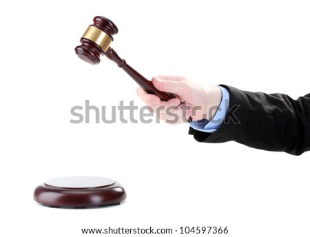 wooden gavel in hand isolated on white - stock photo