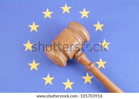 Wooden gavel on european union flag - stock photo