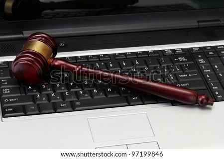 wooden gavel on laptop computer close up - stock photo