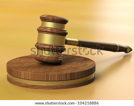 Wooden gavel with brass band resting on block. Isolated on white background