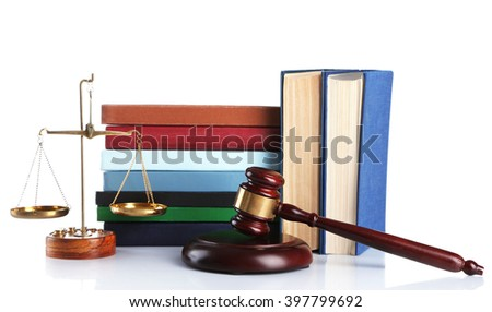 Wooden gavel with justice scales and stacks of books, isolated on white