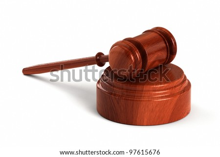 Wooden gavel with sound block over white background - stock photo