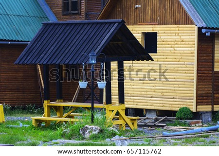 Wooden gazebo with drapery in the courtyard of a private house